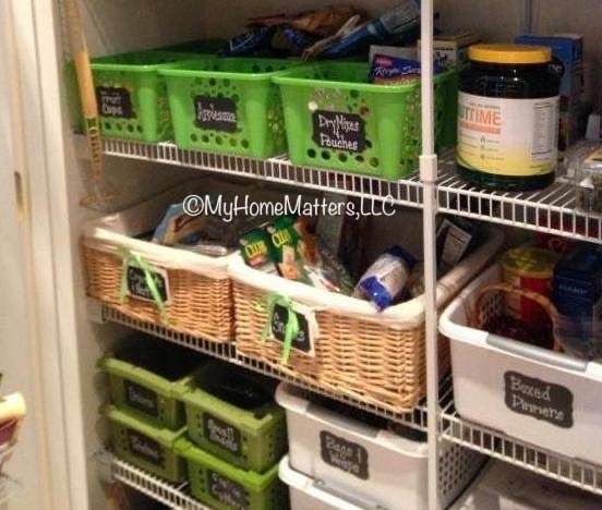 a pantry organized with color coded bins