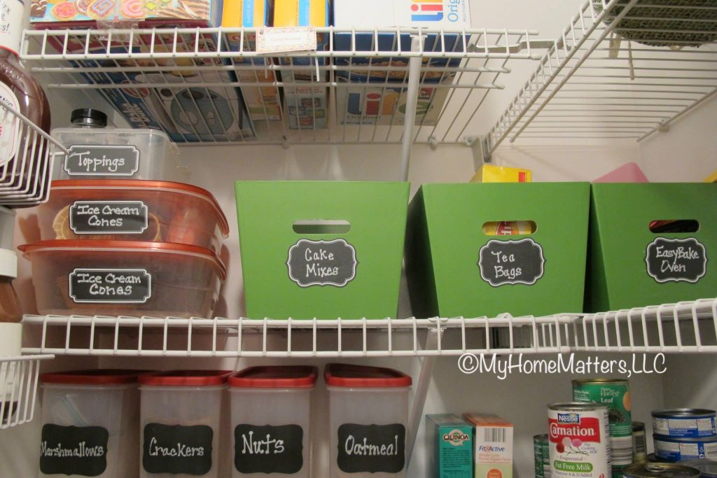 tupperware bins and containers sitting neatly on a pantry shelf