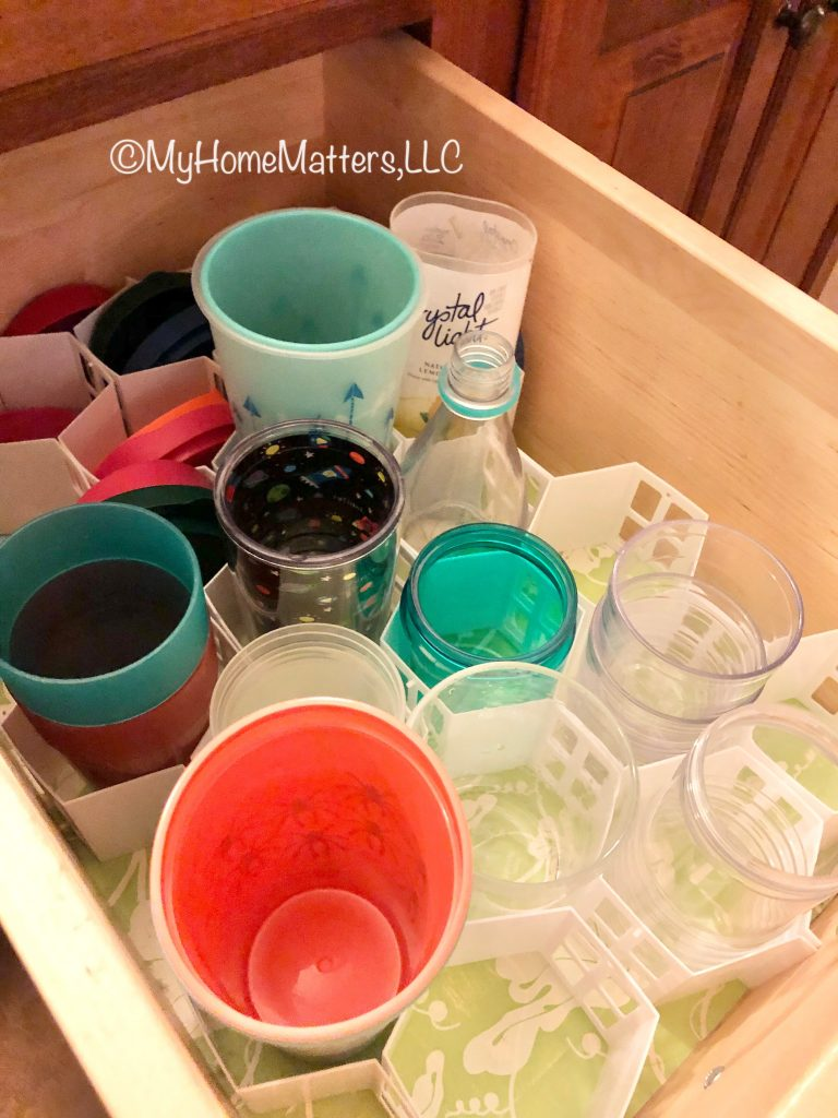 plastic kids cups in a drawer