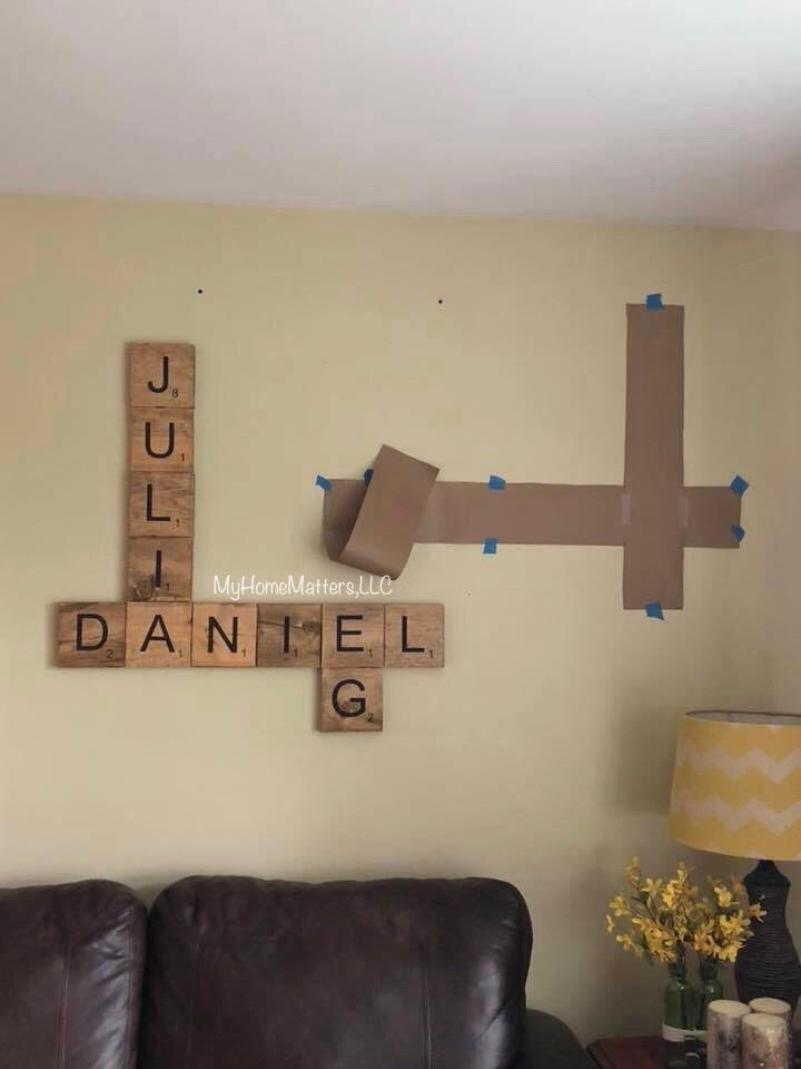 starting to hang scrabble wall tiles on the wall
