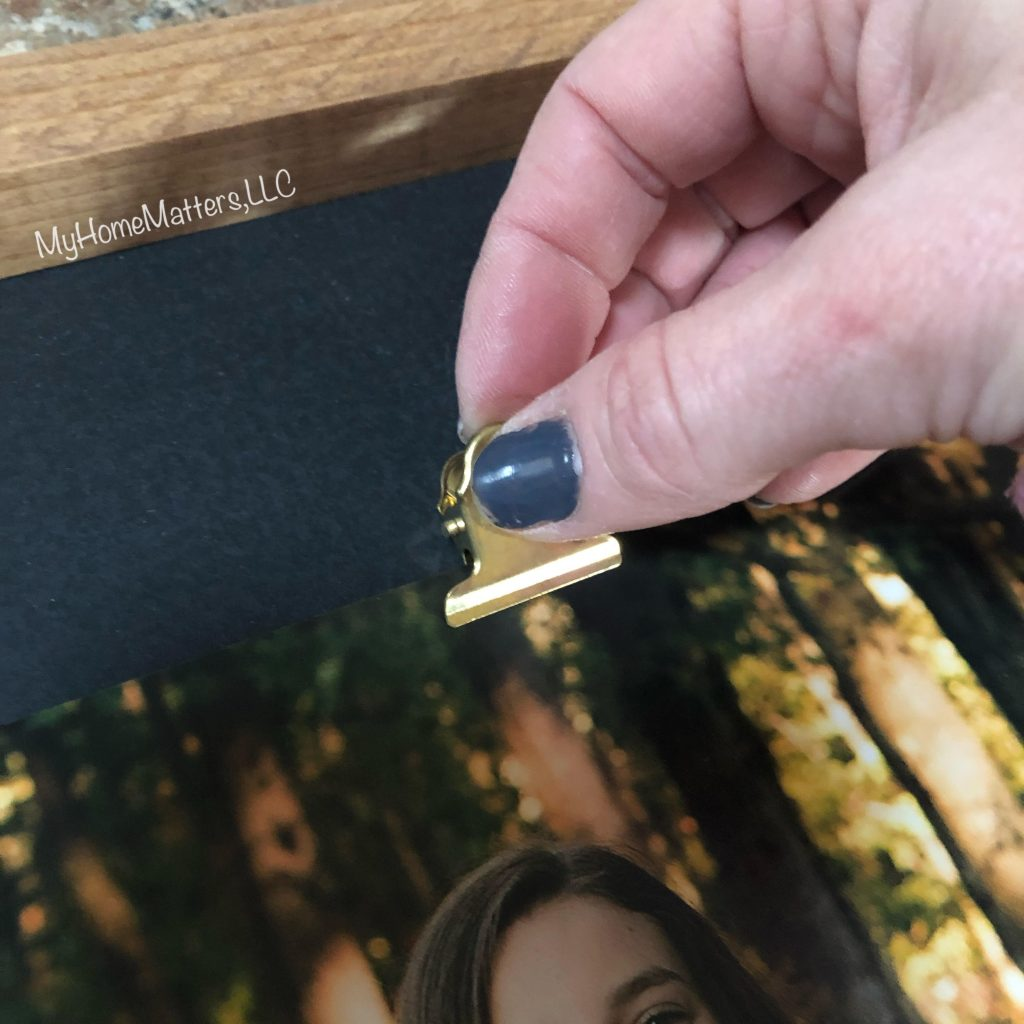 clip being added to a sign for a photo