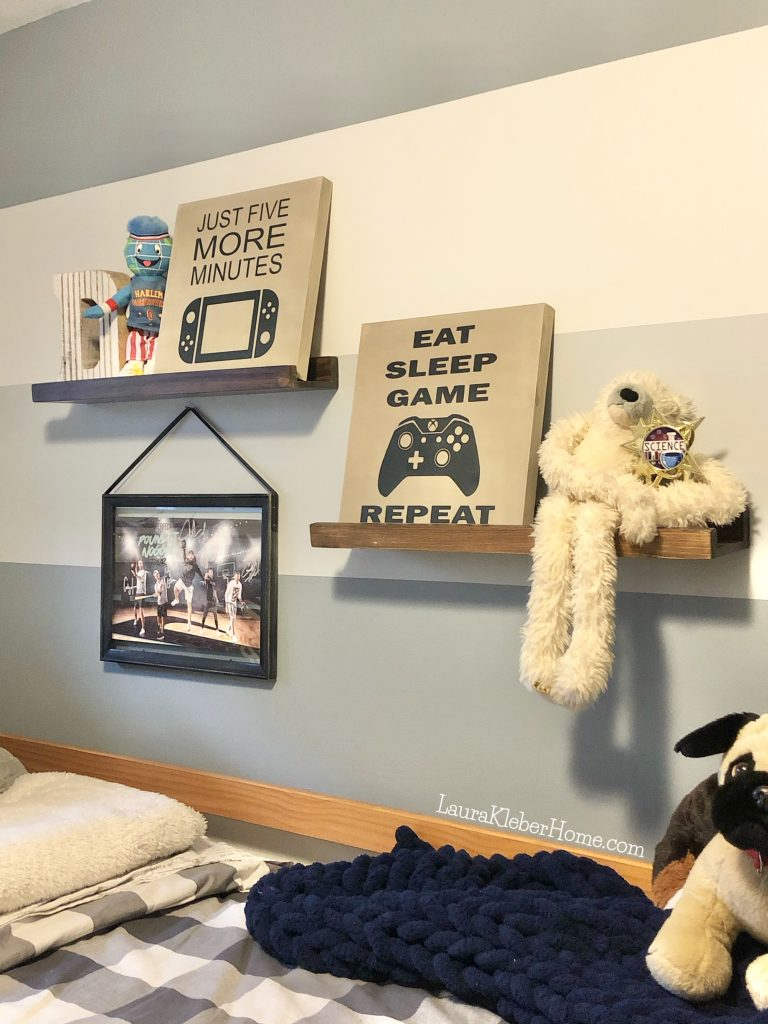 shelves in a boy's room with signs and stuffed animals