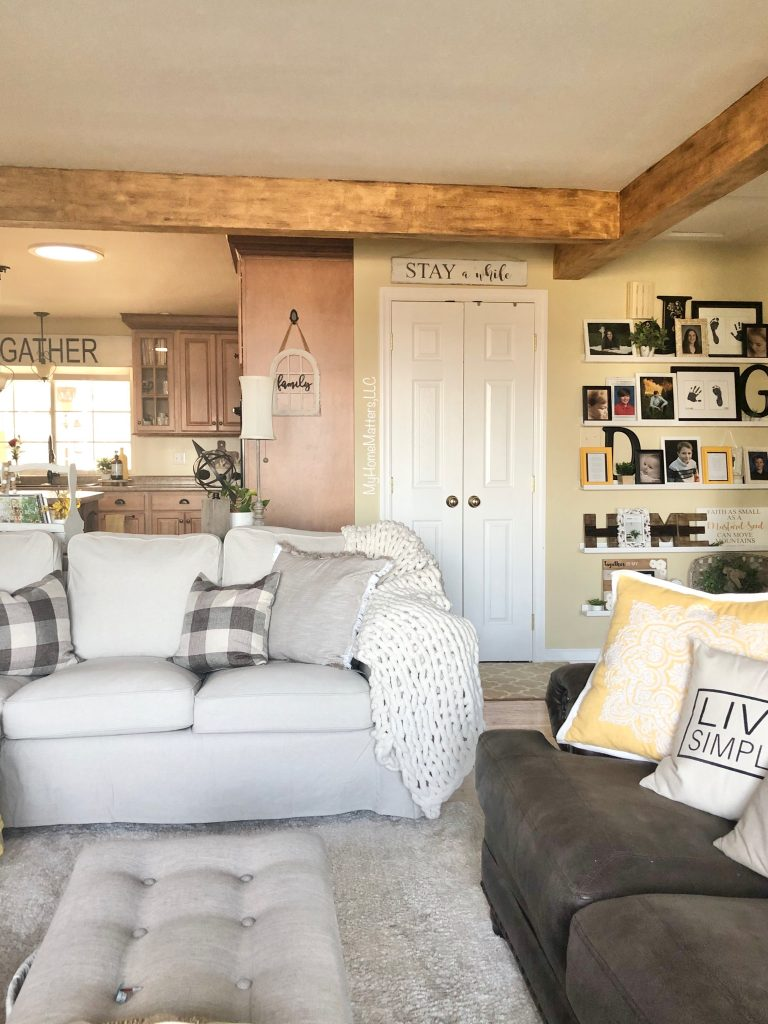 living room with faux wood beams