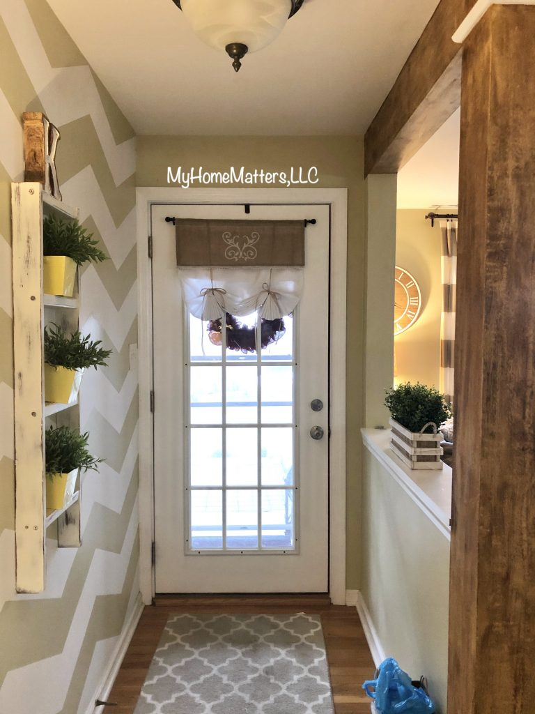 the inside of a front door painted white