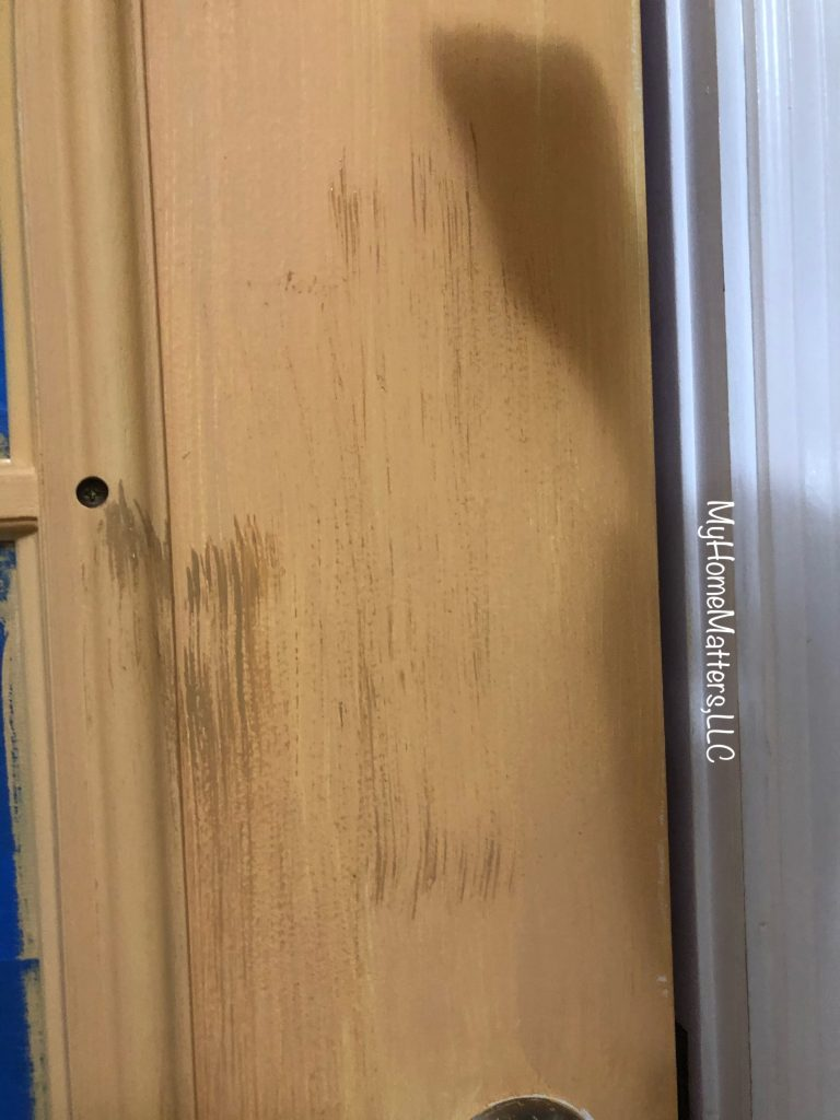 paint being dry brushed onto a door