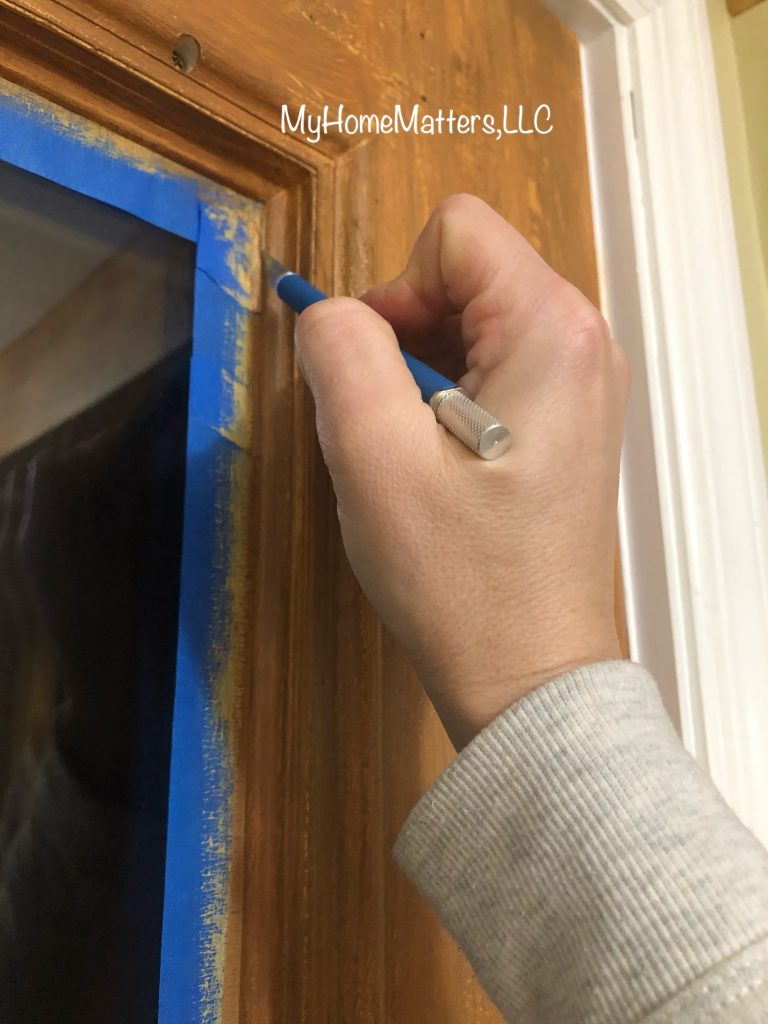 removing painter's tape from the windows on the door