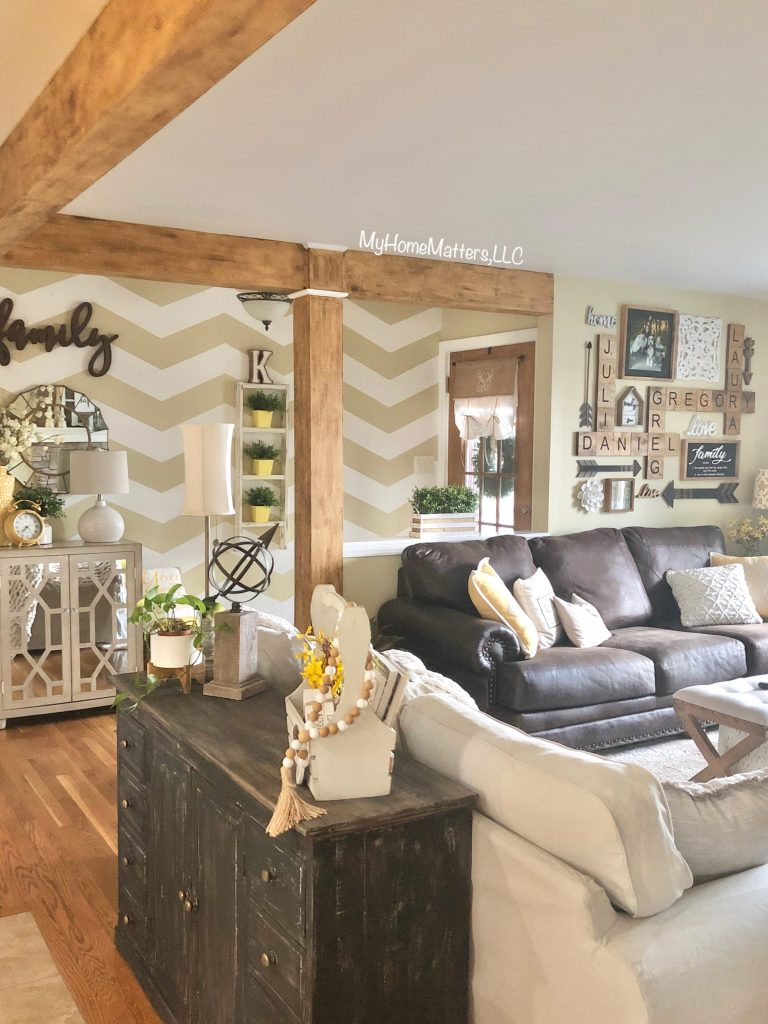 living room with chevron accent wall