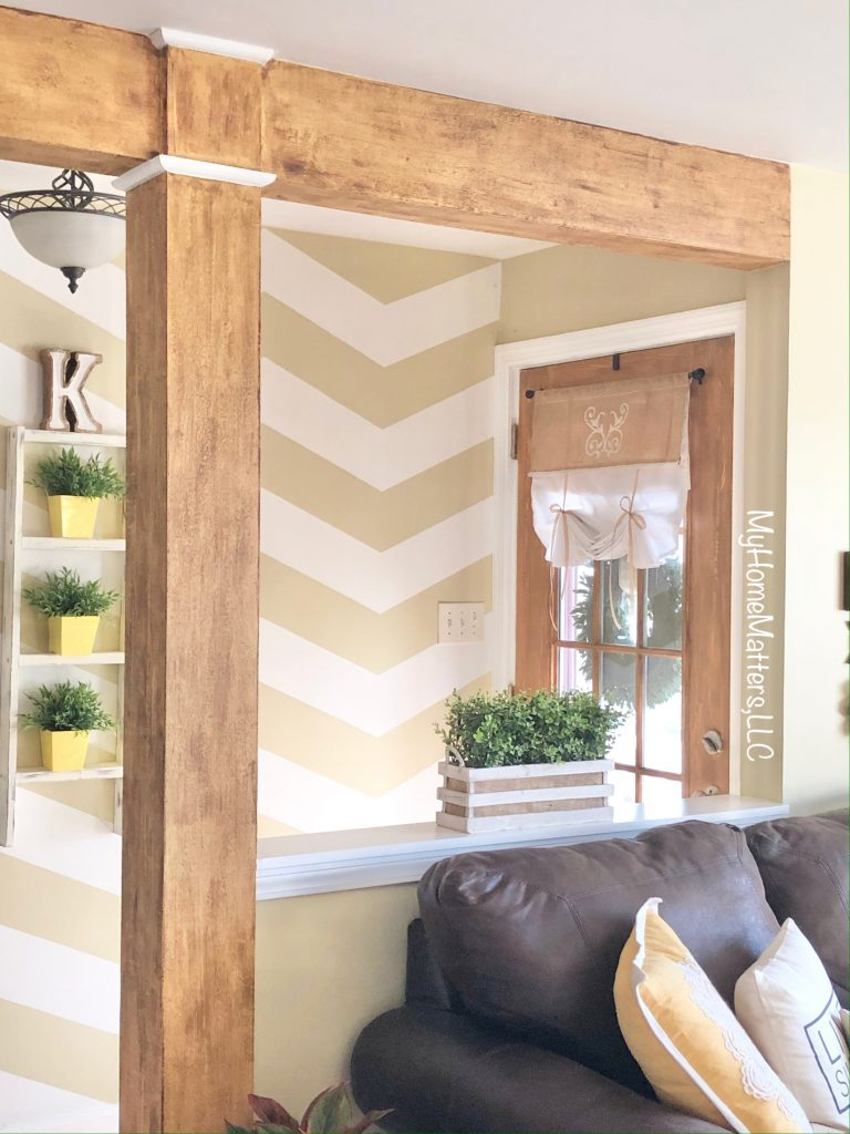 Wooden beams and wooden door done with paint and wax