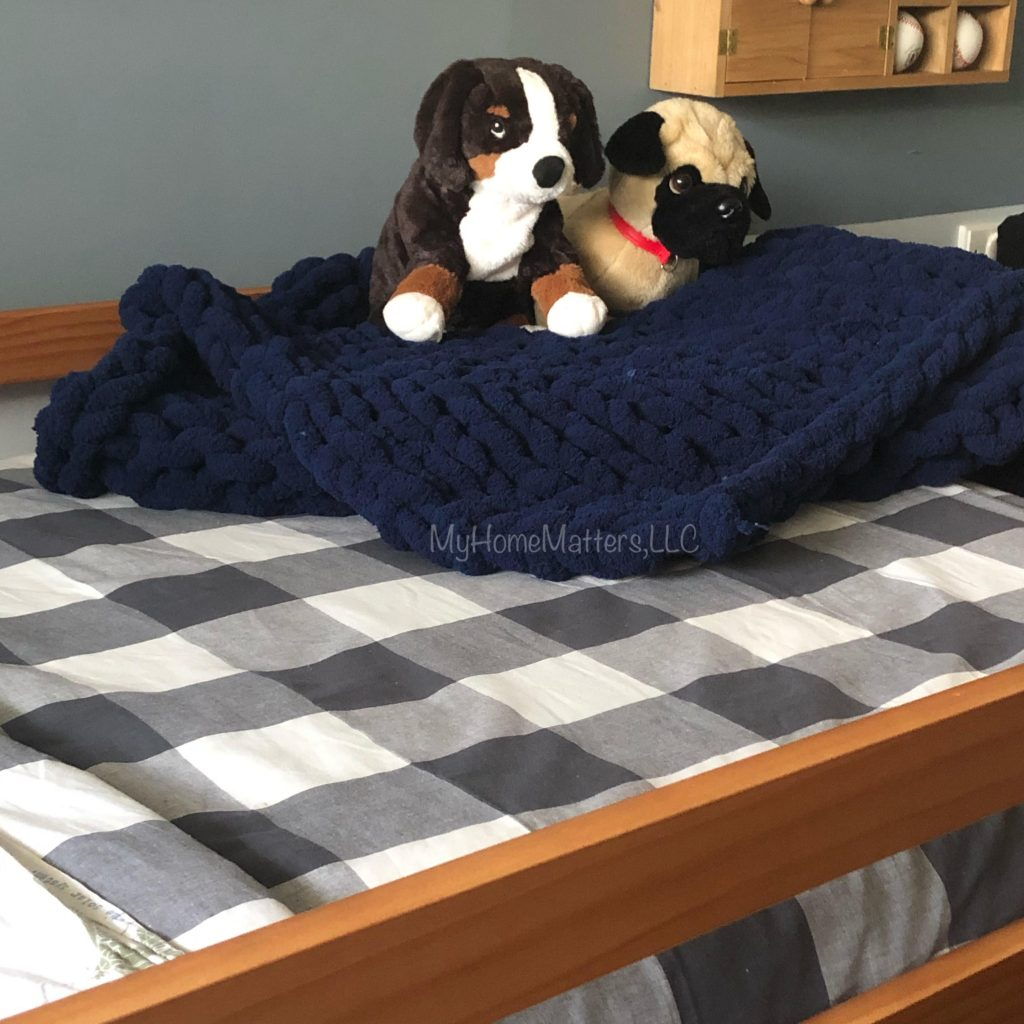 chunky blanket on a boy's bed