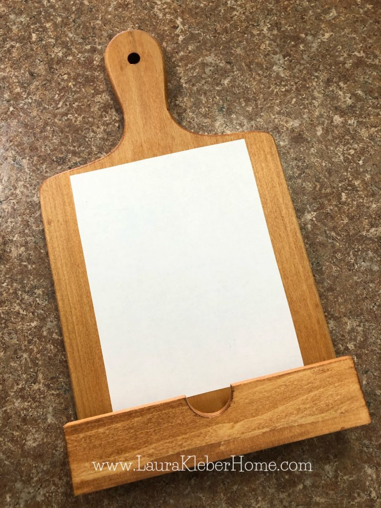 paper applied to a wood cutting board with mod podge