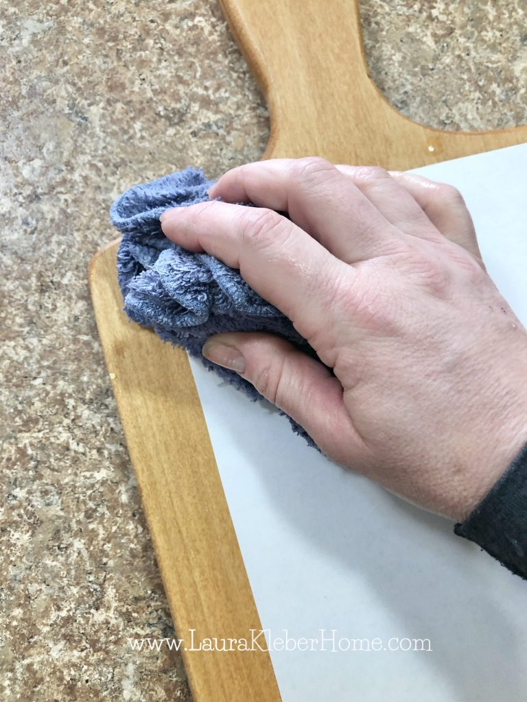 person using a wet washcloth to dampen paper