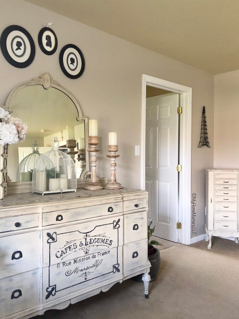 woman's dresser painted cream and stenciled with French saying