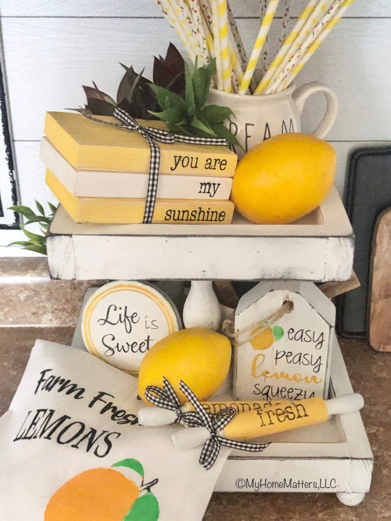 lemon themed decor on a white tiered tray