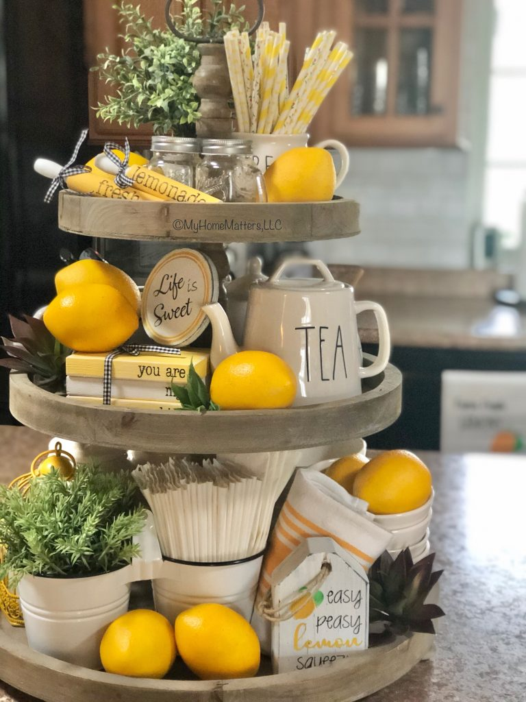 summer themed tiered tray with lemons and greenery