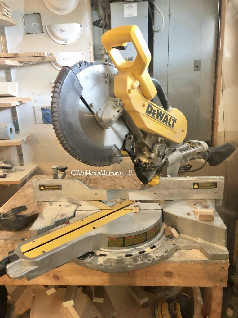 a Dewalt Miter Saw in a garage workshop
