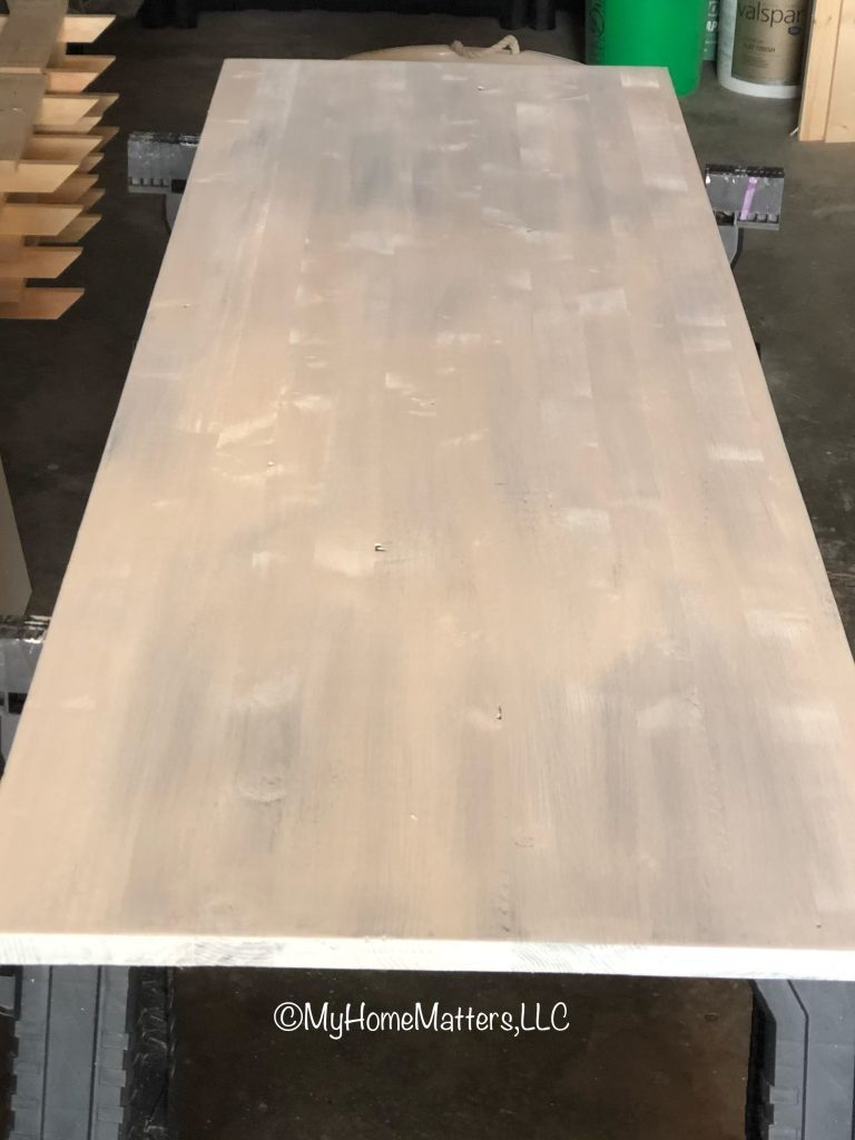a piece of wood painted white