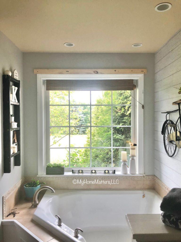 bathroom window with piece of wood attached above