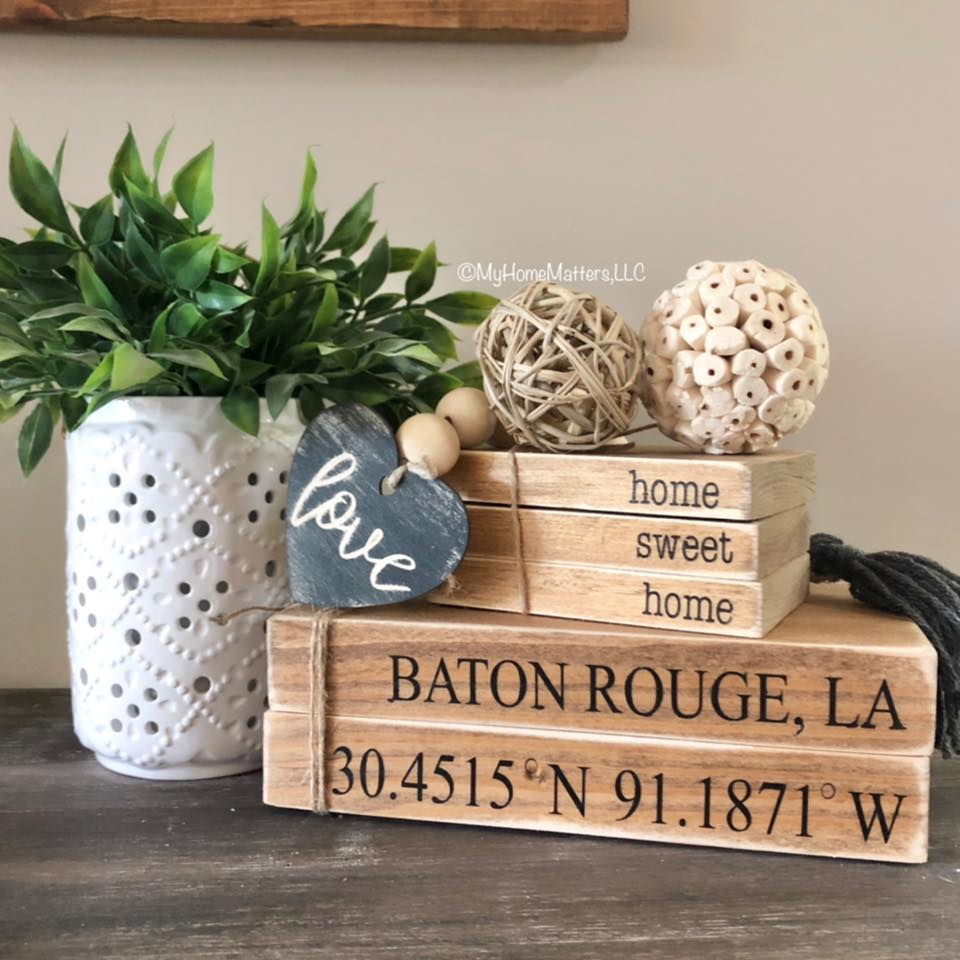 wooden books with city coordinates
