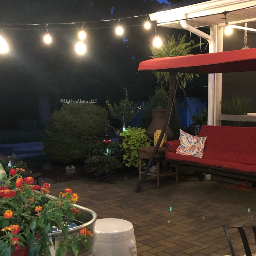 patio lit by string lights