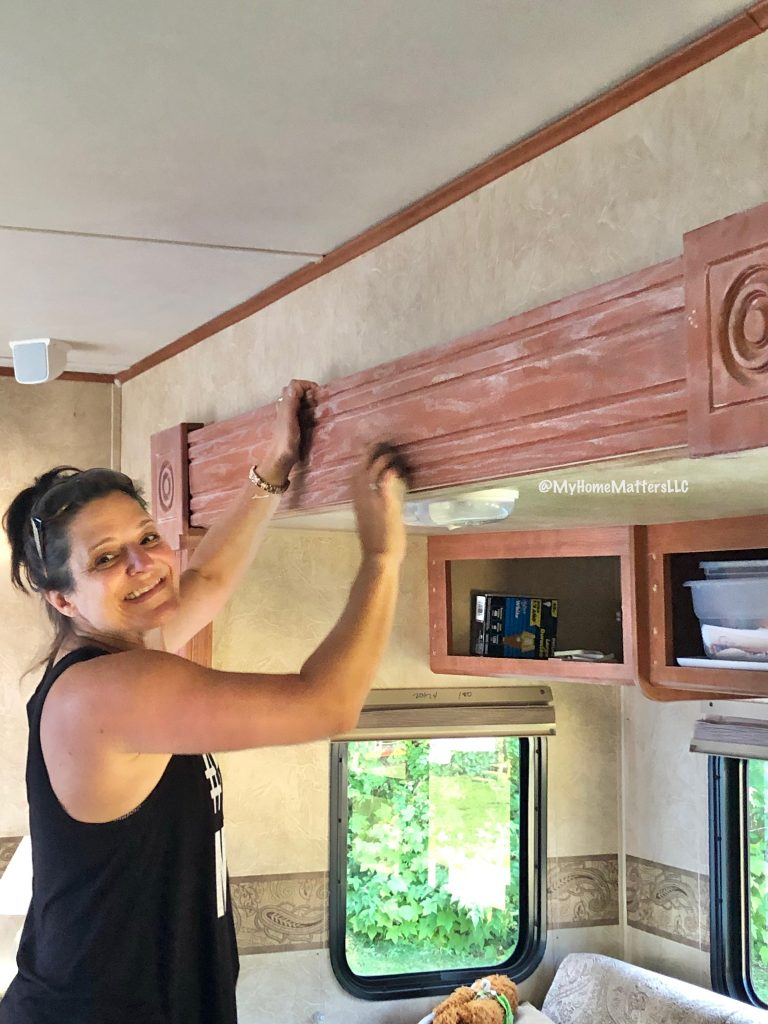 to show me sanding wood in preparation for our camper renovation painting project