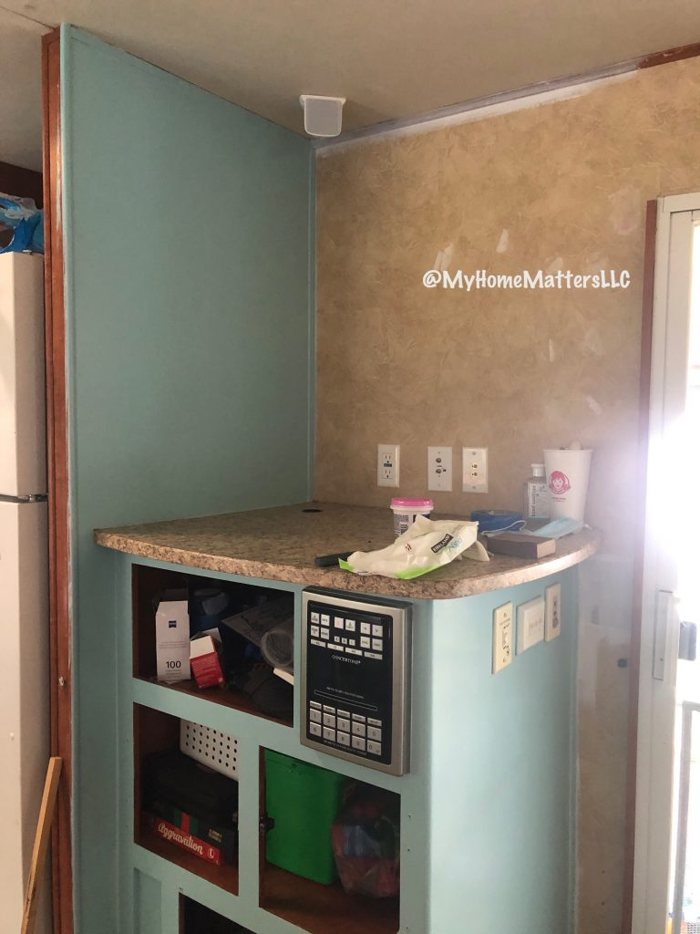 to show progress painting the entertainment center of our camper