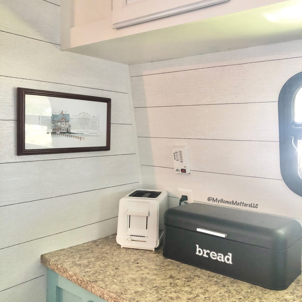 to show a corner of our camper once the shiplap wallpaper was added
