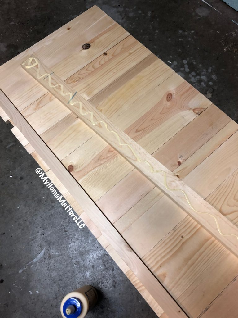 attaching the planks on a DIY rustic wooden headboard