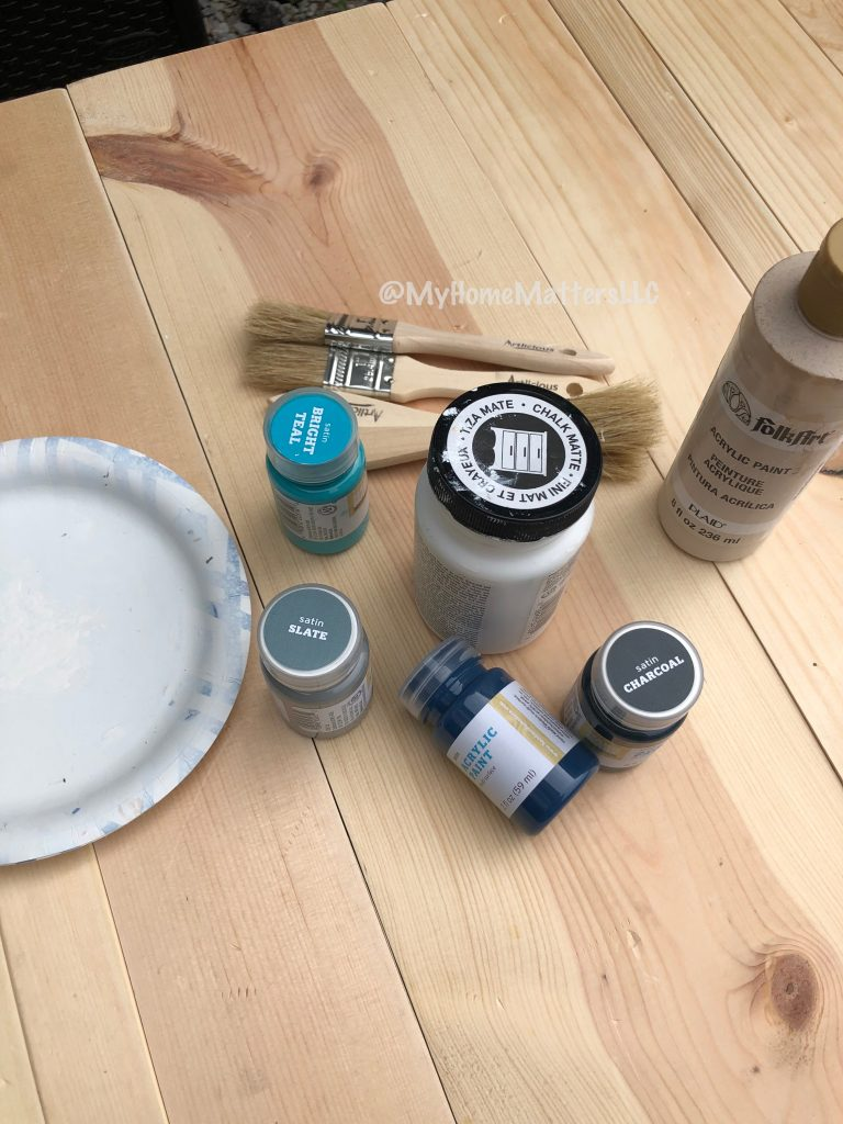 chip brushes, and paint on top of raw wood used to make a rustic headboard