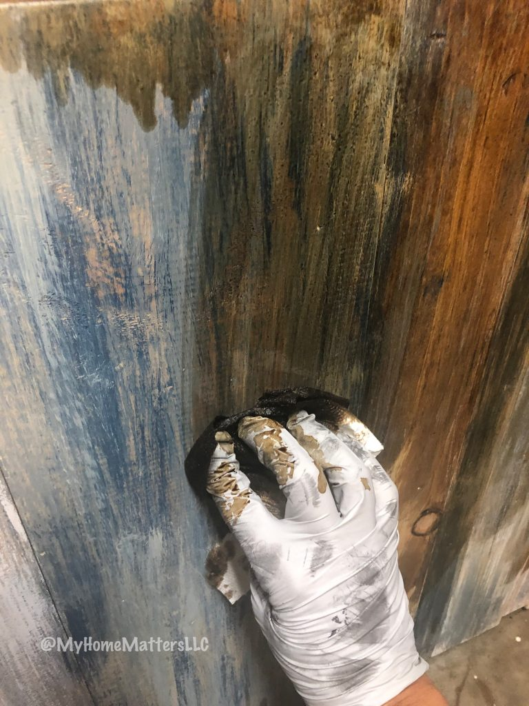 applying Early American stain over paint on DIY rustic wooden headboard