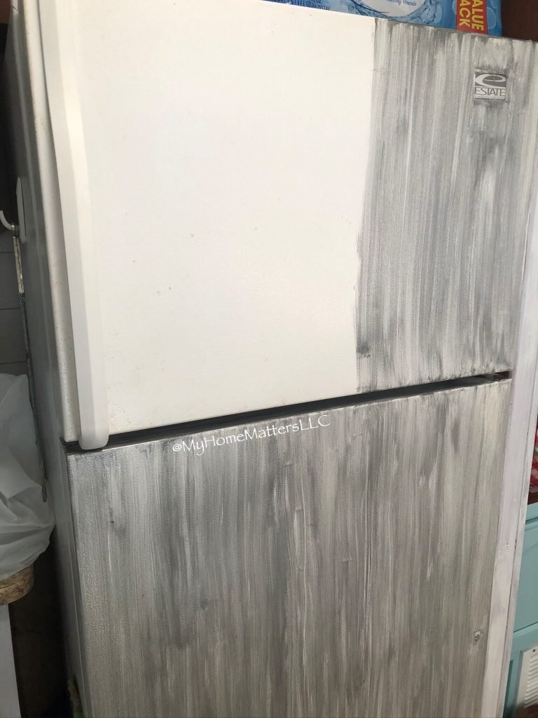 refrigerator being painted with appliance paint