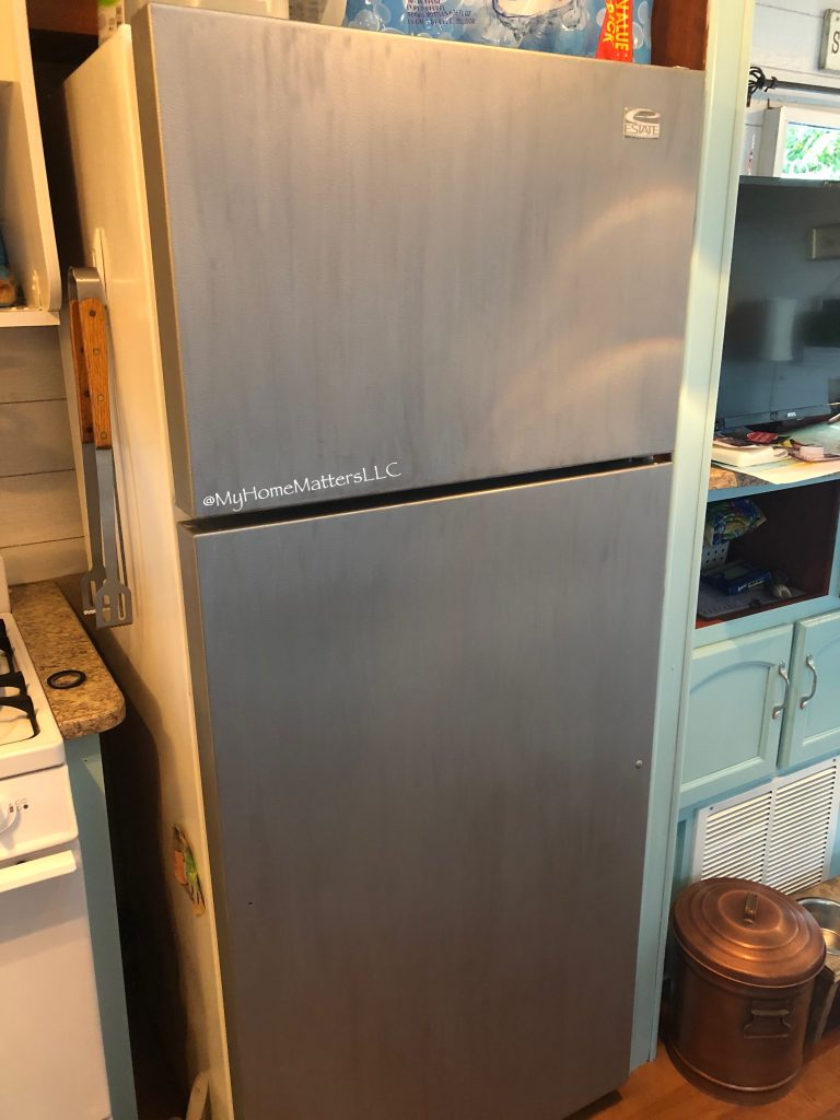 three coats of stainless steel appliance paint applied to a refrigerator door