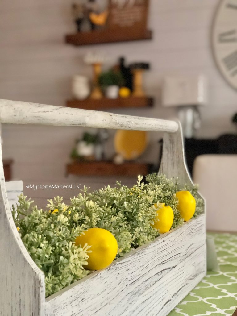 greenery placed inside a toolbox as a dining table centerpiece