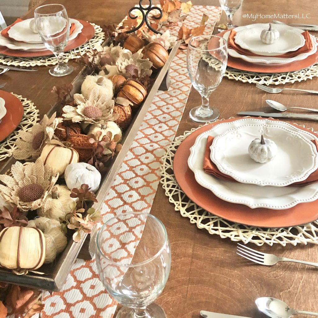Fall themed table with oranges, browns and pumpkins