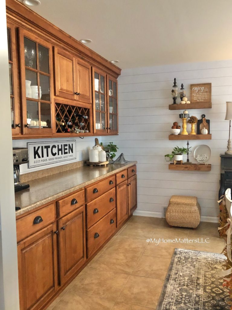 """a kitchen bar and floating shelves and sign that says """"kitchen"""""""
