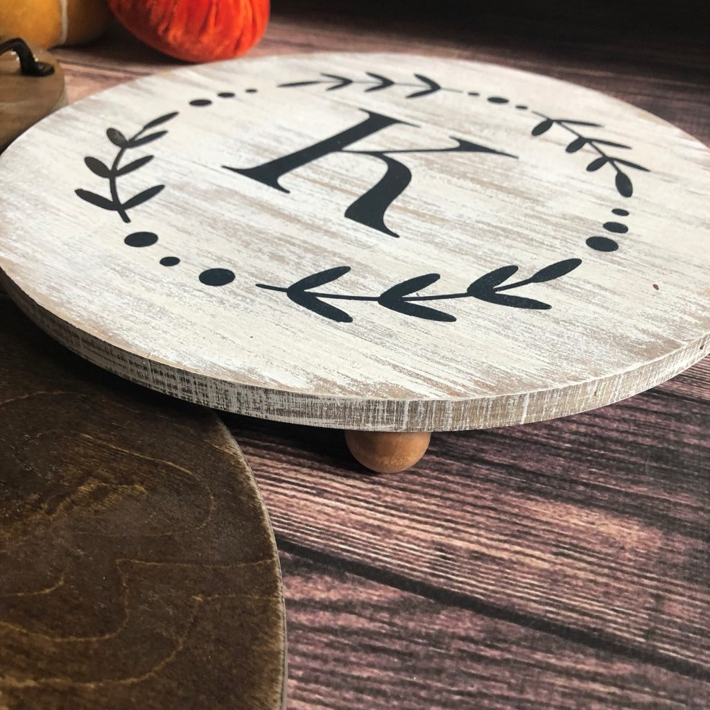farmhouse style round platter with a K painted on it