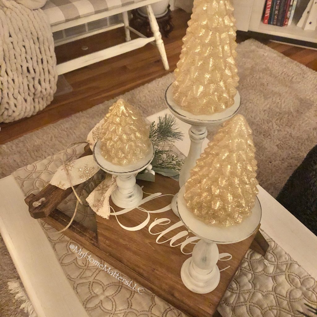 DIY wooden mini sled displayed on coffee table with candles on top