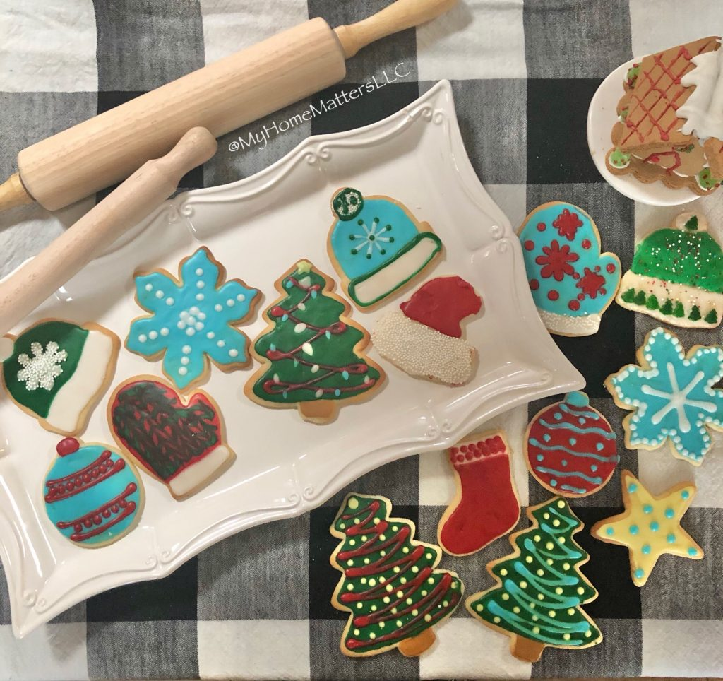 decorated sugar cookies on a plate and tablecloth