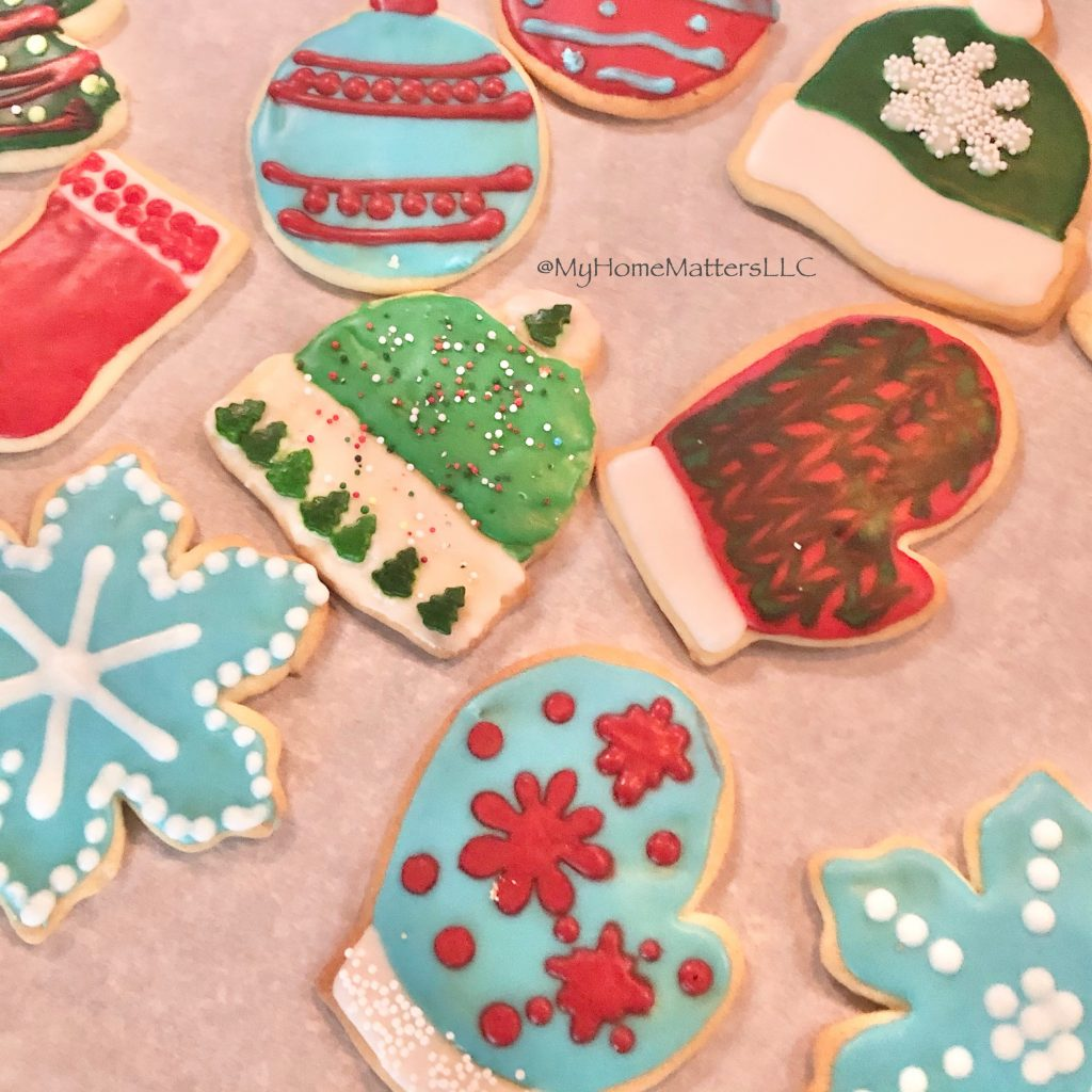 decorated sugar cookies in bright reds, greens and blues